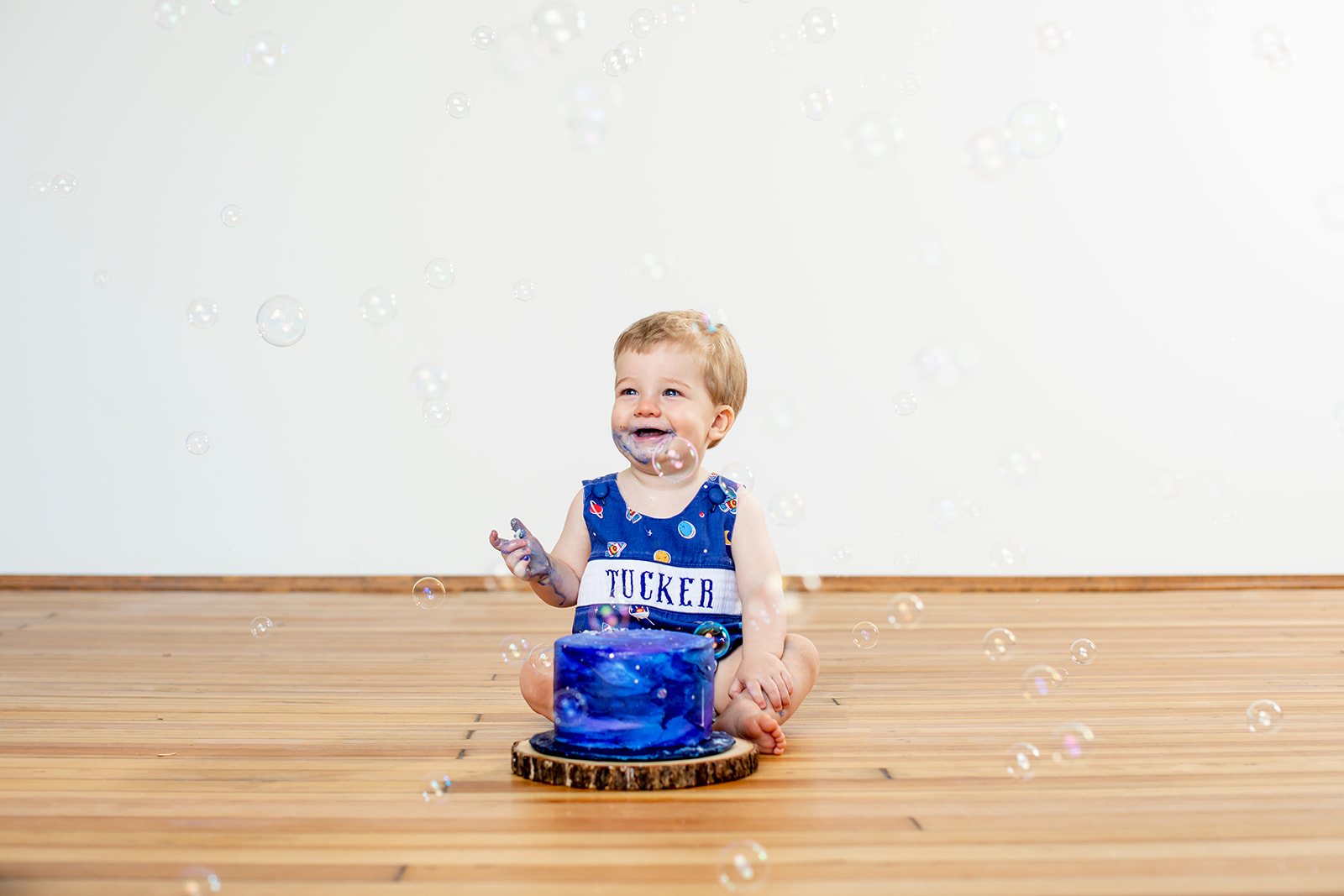 Tuckers First Birthday Cake Smash Photo Shoot - Image Property of www.j-dphoto.com