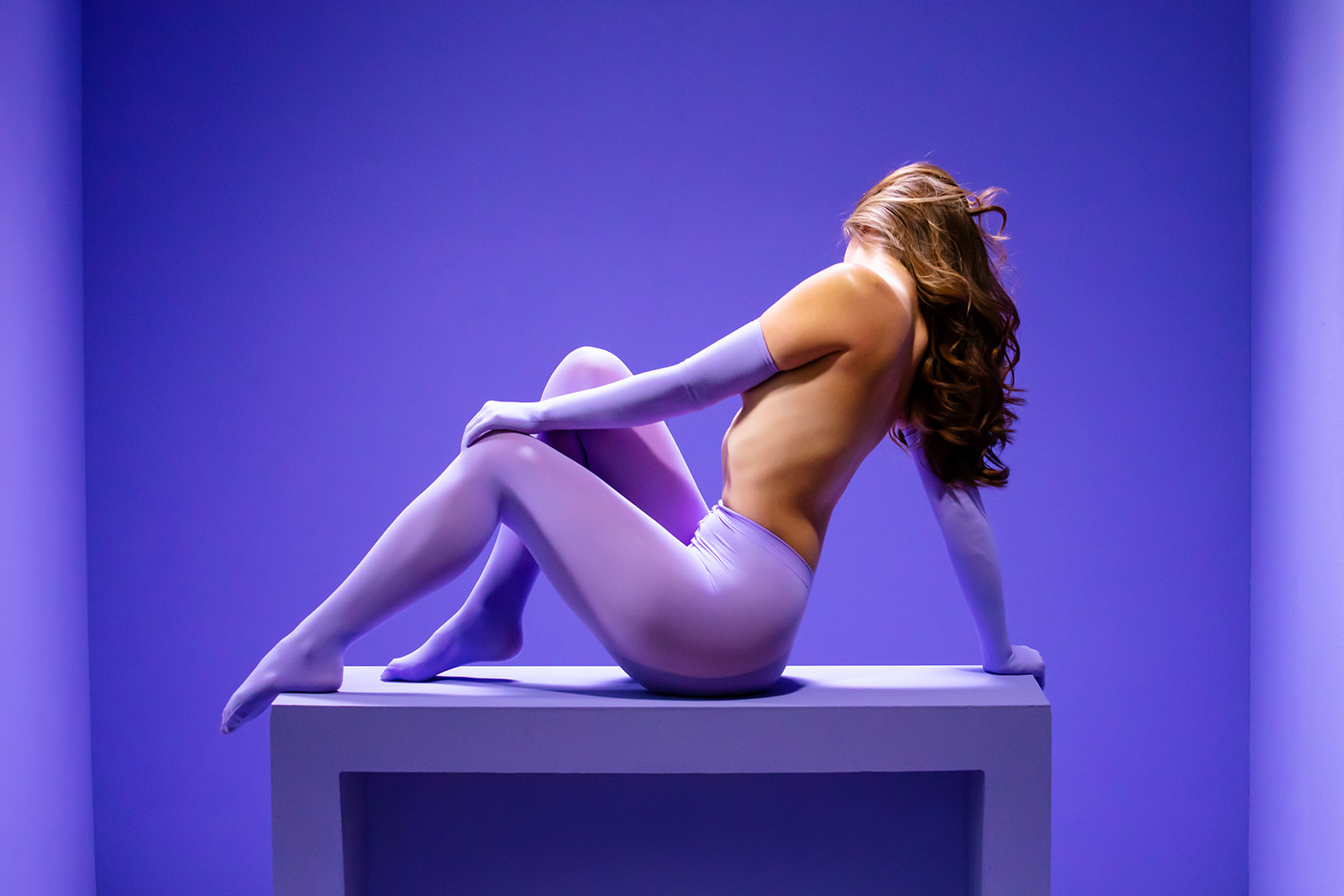 Purple Tights Sculpture in a Purple Cube Editorial - Image Property of www.j-dphoto.com